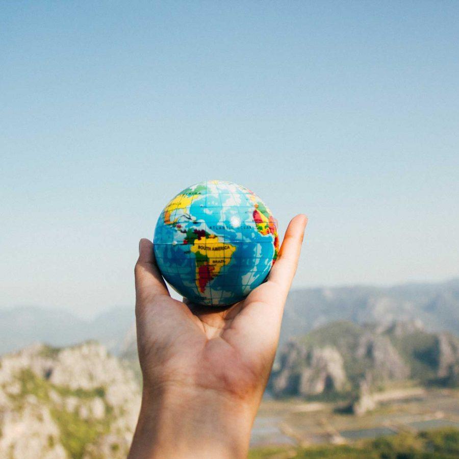 Handing holding globe