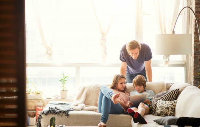 family in sunny living room