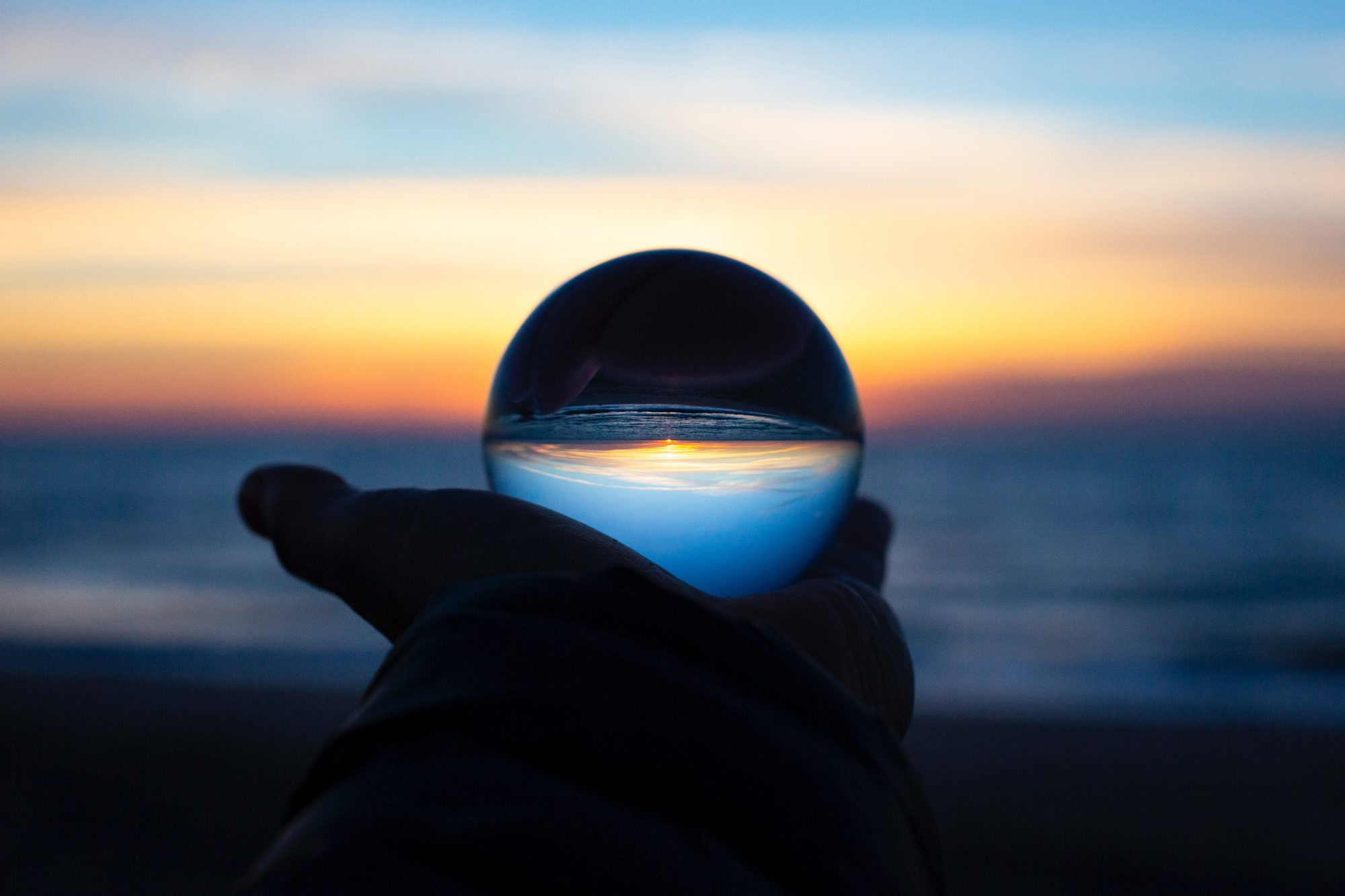 Holding an orb over the ocean
