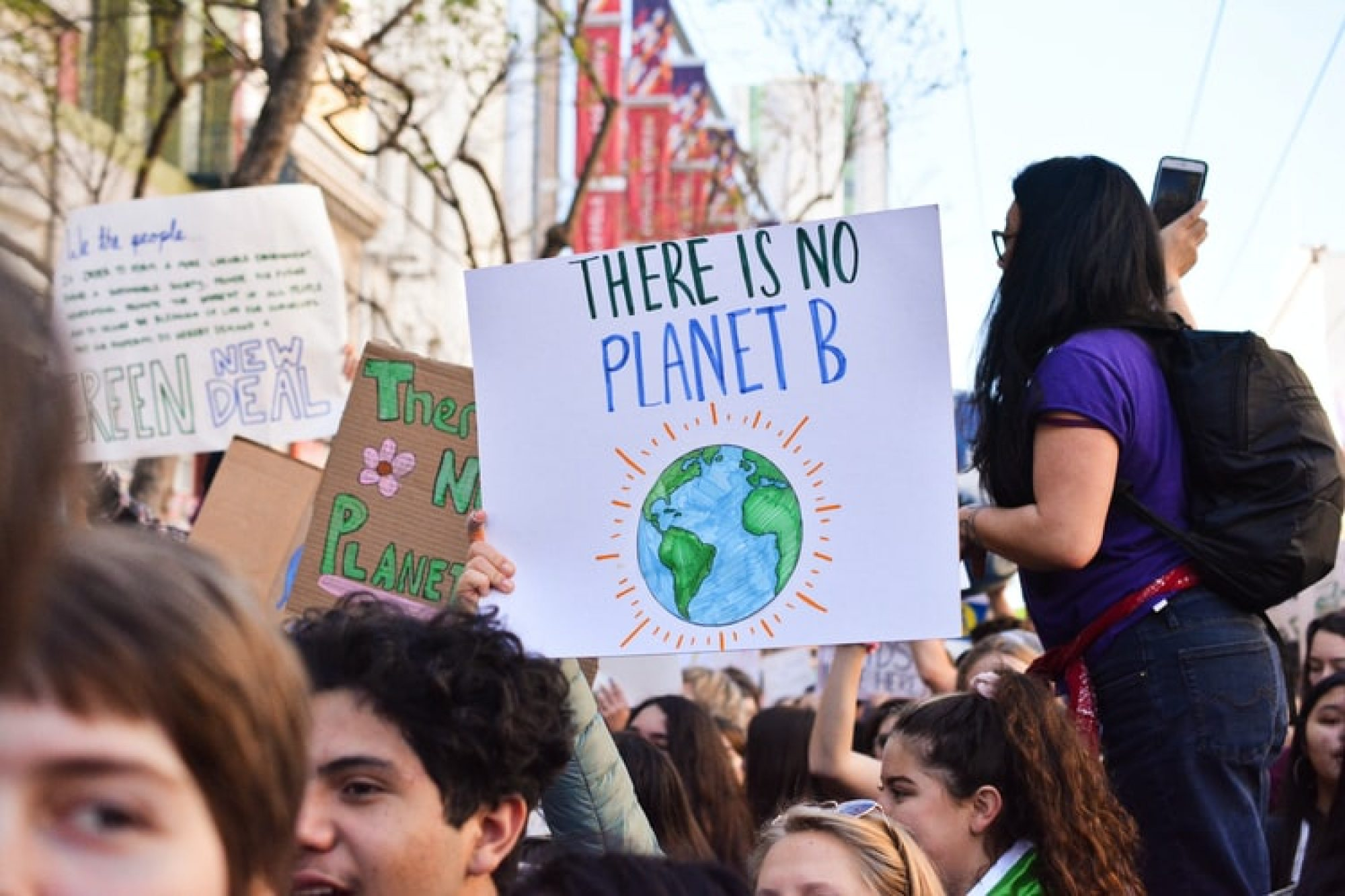 "A climate change protest with a sign that reads ""there is no planet B"""
